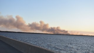 Authorities say firefighters in the Florida Panhandle are battling wildfires that have forced some 1,600 people to evacuate from their homes.
