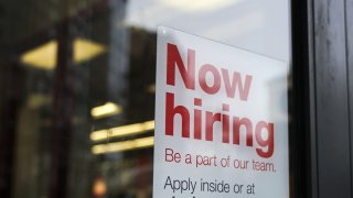 "In this Jan. 4, 2019, file photo, a ""now hiring"" sign hangs on the door of a Staples store in New York City."