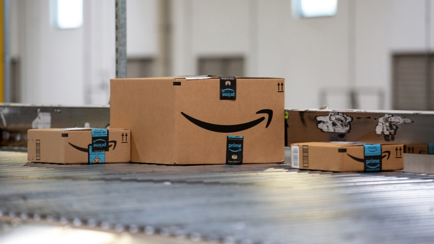 AMAZON packages on a conveyor belt