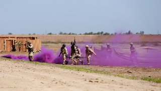 Iraqi soldiers take part in a military exercise at Camp Taji, north of Baghdad, Iraq, Monday, March 20, 2017.