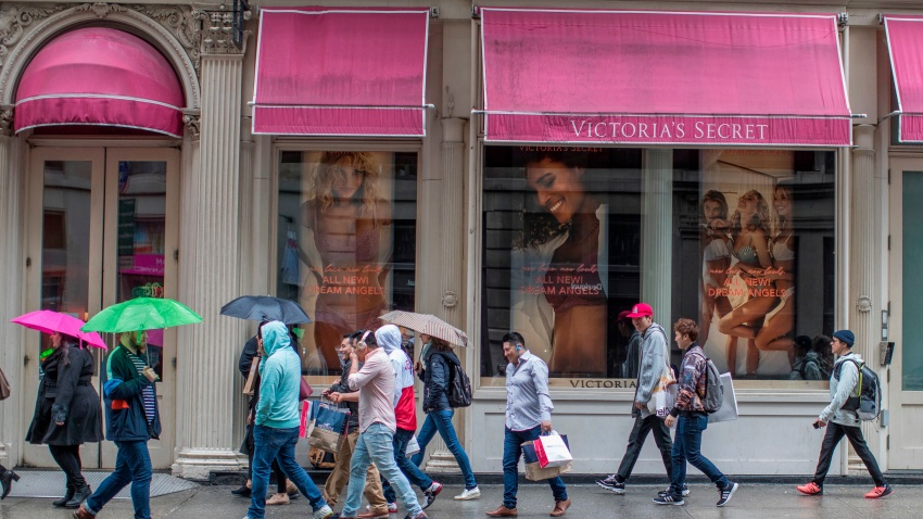 FILE- In this April 4, 2018, file photo, shoppers walk past the Victoria's Secret store on Broadway in the Soho neighborhood of New York.