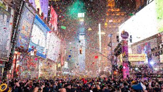 In this Jan. 1, 2020, file photo, confetti falls at midnight on the Times Square New Year's Eve celebration in New York.