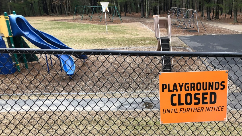 This Friday, March 20, 2020 file photo shows a closed sign near an entrance to a playground