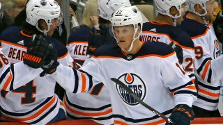 Edmonton Oilers' Colby Cave (12) returns to the bench after scoring during the second period of an NHL hockey game