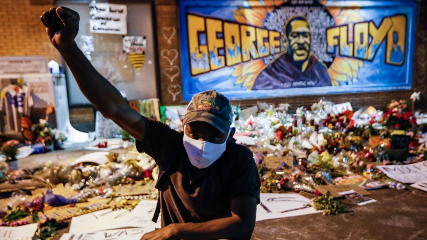 In this Monday, June 1, 2020 file photo, protesters gather at a memorial for George Floyd where he died outside Cup Foods on East 38th Street and Chicago Avenue in Minneapolis.