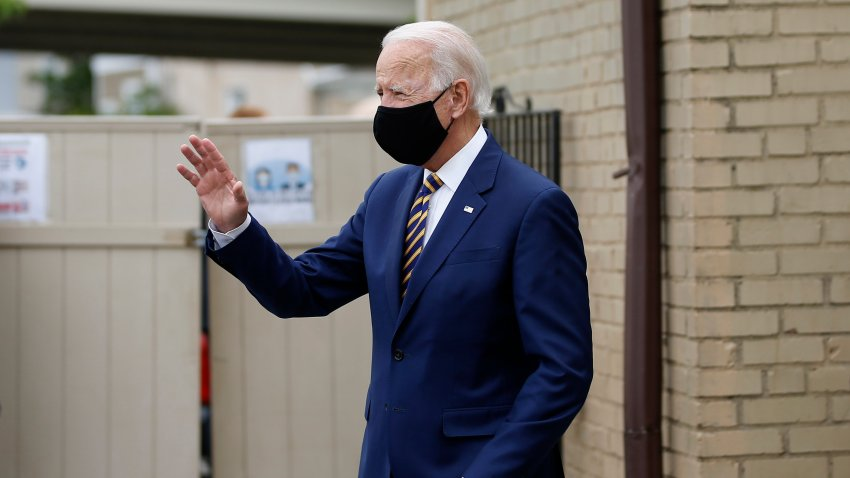Democratic presidential candidate, former Vice President Joe Biden waves as he arrives to meet with with small business owners, Wednesday, June 17, 2020, at Carlette's Hideaway, a soul food restaurant, in Yeadon, Pa.