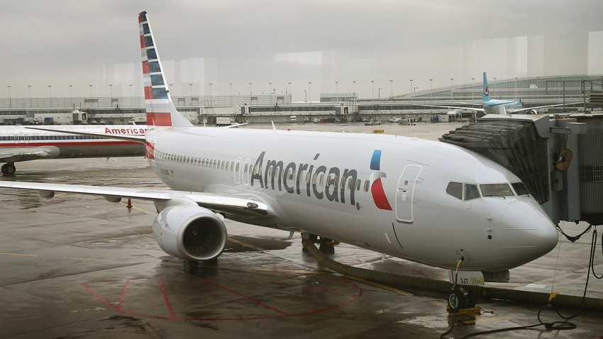 In this Jan. 29, 2013, file photo, a new American Airlines 737-800 aircraft featuring a new paint job with the company's new logo sits at a gate at O'Hare Airport in Chicago, Illinois.