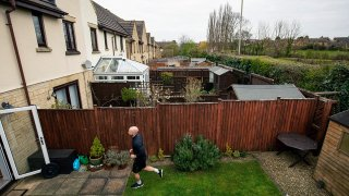 James Campbell runs a charity marathon to raise funds for the NHS, in his garden, while the country is in lockdown to control the spread of coronavirus, in Cheltenham, England, April 1, 2020.