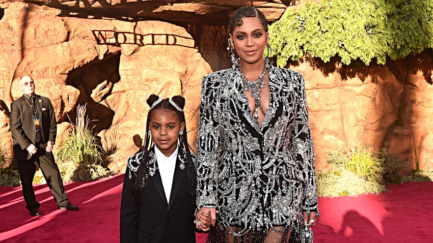 """Blue Ivy Carter (L) and Beyonce Knowles-Carter attend the World Premiere of Disney's """"The Lion King"""" at the Dolby Theatre, July 9, 2019, in Hollywood, Calif."""