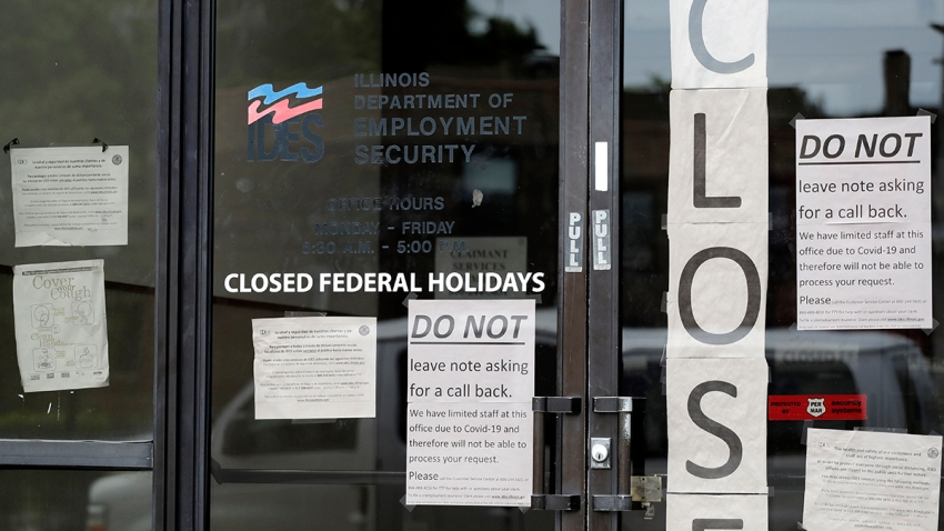 Information signs are posted at the Illinois Department of Employment Security office, June 5, 2020, in Chicago.