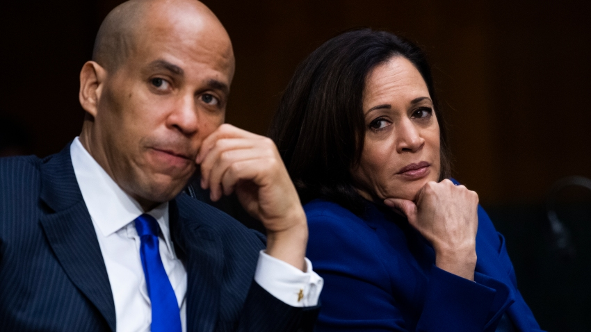 Sen. Cory Booker, D- N.J., and listen Sen. Kamala Harris, D-Calif., during a Senate Judiciary Committee hearing on police use of force and community relations on on Capitol Hill, Tuesday, June 16, 2020 in Washington.
