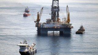 Ships work near the site of the BP Deepwater Horizon oil spill