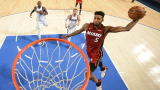 Derrick Jones Jr. #5 of the Miami Heat dunks the ball against the Dallas Mavericks on Dec. 14, 2019 at the American Airlines Center in Dallas, Texas.