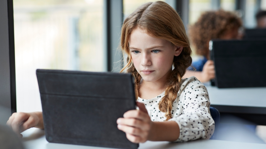 A file image of a girl reading on tablet