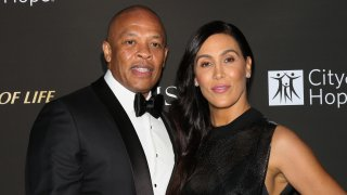 Rapper / Music Producer Dr. Dre (L) and his Wife Nicole Young (R) attend the City Of Hope Gala on October 11, 2018 in Los Angeles, California.