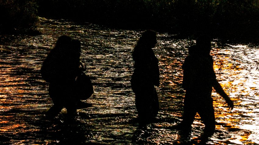 Central American migrants cross the Rio Grande river in Ciudad Juarez, state of Chihuahua, Mexico, on June 12, 2019, before turning themselves in to U.S. Border Patrol agents to ask for asylum.
