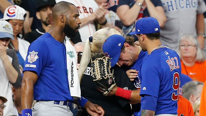 Albert Almora Jr. #5 of the Chicago Cubs, center, is comforted by Jason Heyward #22 and Javier Baez #9 after checking on a young child that was struck by a hard foul ball off his bat in the fourth inning against the Houston Astros at Minute Maid Park on May 29, 2019 in Houston, Texas.