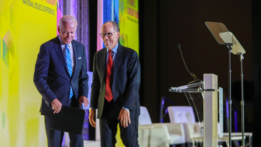 Former U.S. Vice President Joe Biden, a 2020 Democratic presidential candidate, and Tom Perez, chairman of the Democratic National Committee (DNC), exit the stage during the DNC Women's Leadership Forum conference in Washington, D.C., U.S., on Thursday, Oct. 17, 2019.