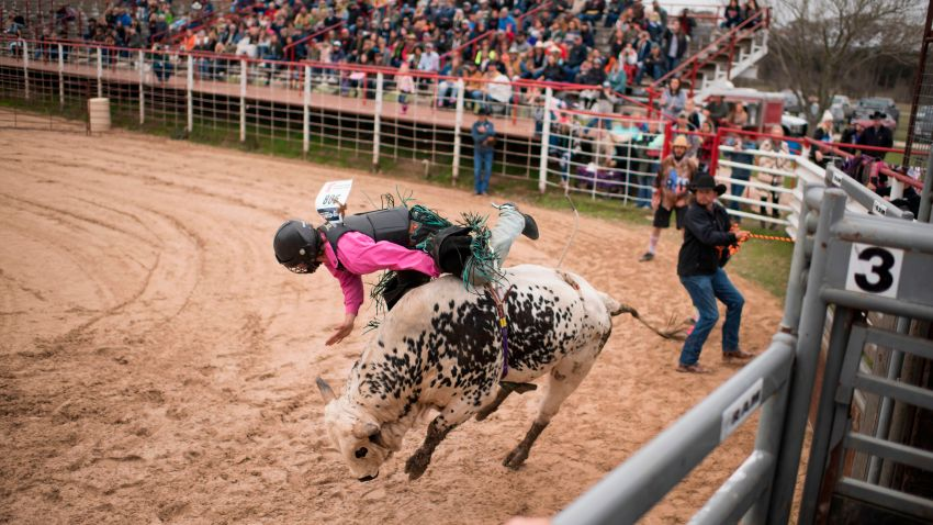 File photo - Tyler Fender, 17, is bucked off a bull during the Cowboy Mardi Gras Bull Riding and Mini Bull Riding Competition in Bandera, Texas, on Feb. 15, 2020.