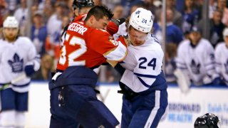The Florida Panthers' MacKenzie Weegar fights with the Toronto Maple Leafs' Kasperi Kapanen during the first periodat the BB&T Center in Sunrise, Fla., on Thursday, Feb. 27, 2020.