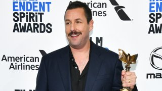 "In this Feb. 8, 2020, file photo, Adam Sandler, winner of Best Male Lead for ""Uncut Gems,"" poses in the press room at the 2020 Film Independent Spirit Awards in Santa Monica, California."