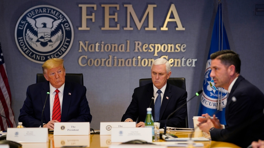 President Donald Trump, left, and Vice President Mike Pence listen as Acting Secretary of Homeland Security Chad Wolfspeaks during a teleconference with governors at the Federal Emergency Management Agency headquarters on March 19, 2020, in Washington, DC.