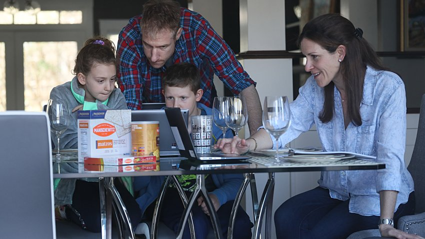 The Goldwasser family, Matthew, JulieSue, Ari, 9, Alison, 7, have a Zoom rehearsal for their seder which they will be having virtually with other families at the Rashi School in Needham, MA on Apr. 7, 2020.