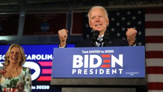 In this Feb. 29, 2020, file photo, Democratic presidential candidate former Vice President Joe Biden reacts on stage with his wife Jill Biden after declaring victory in the South Carolina presidential primary in Columbia, South Carolina.