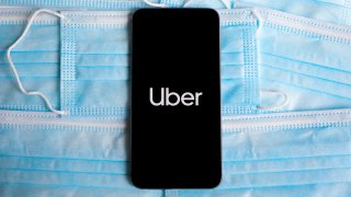 Uber logo is displayed on a mobile phone screen