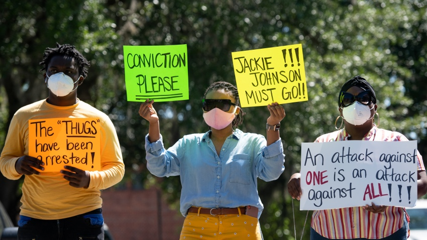 In this May 8, 2020, file photo, demonstrators protest the shooting death of Ahmaud Arbery at the Glynn County Courthouse in Brunswick, Georgia. Gregory McMichael and Travis McMichael were arrested the previous night and charged with murder.
