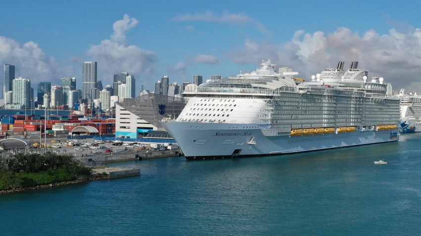 An aerial view from a drone shows the Royal Caribbean Symphony of the Seas Cruise ship which is the world's largest passenger liner docked at PortMiami after returning to port from a Eastern Caribbean cruise as the world deals with the coronavirus outbreak on March 14, 2020 in Miami, Florida.