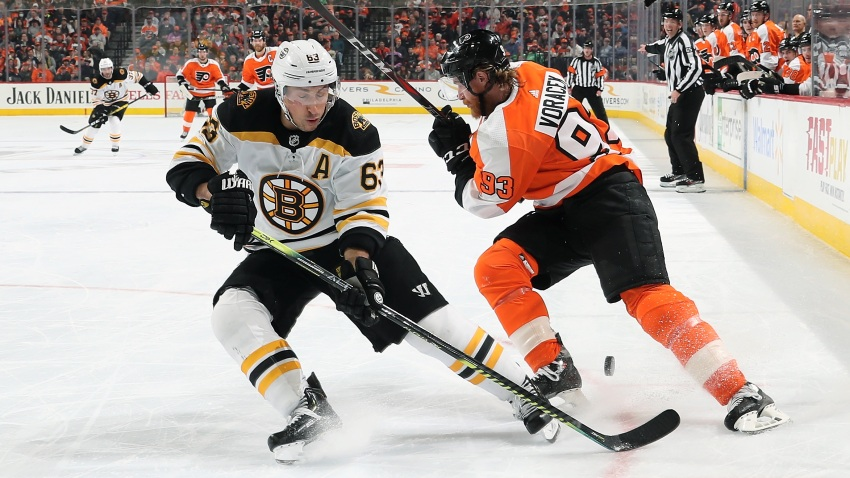 Brad Marchand of the Boston Bruins passes the puck between the legs of Jakub Voracek of the Philadelphia Flyers on March 10, 2020 at the Wells Fargo Center in Philadelphia.