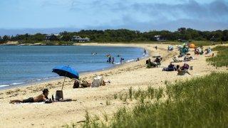 People sit on the beach on Martha's Vineyard in Oak Bluffs, Massachusetts, U.S., on Thursday, June 18, 2020.