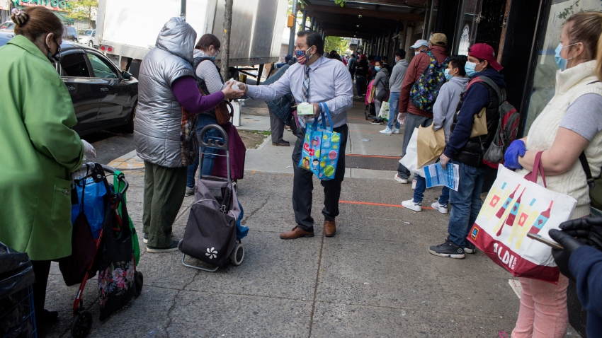 A long line forms to receive free food from a food pantry run by the Council of Peoples Organization on May 15, 2020 in the Midwood neighborhood of Brooklyn, New York.