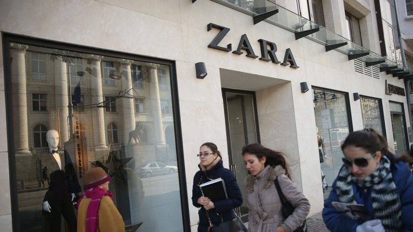In this Dec. 7, 2013, file photo, young women walk past a Zara clothing store in Sofia, Bulgaria.