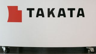 A Takata Corp. logo is seen on display at a car showroom on June 26, 2017 in Tokyo, Japan. Japanese air bag maker Takata Corp. has filed for bankruptcy protection in Tokyo and the U.S. on June 26, 2017, overwhelmed by the outcome following its production of faulty air bag inflators that are linked to the death of more than 180 people globally. The company announced most of its assets will be bought by the Detroit rival, Key Safety Systems for about $1.6 billion (175 billion yen). (Photo by Christopher Jue/Getty Images)