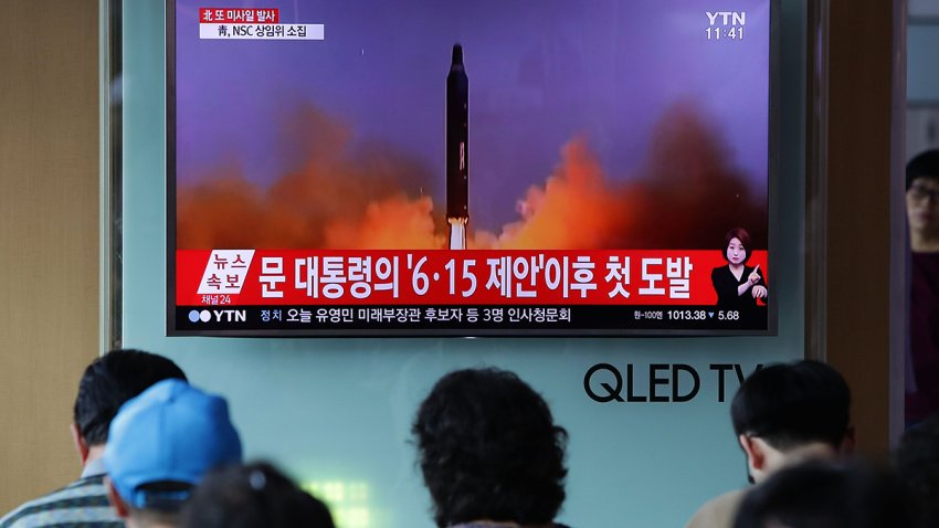 In this July 4, 2017, file photo, people watch a television broadcast reporting a North Korean missile launch at the Seoul Railway Station in Seoul, South Korea.