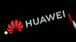 In this April 8, 2020, file photo, the Huawei logo is seen on a building in Warsaw, Poland.