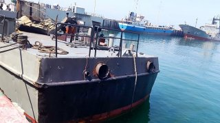A handout picture provided by Iranian army official website on May 11, 2020, shows the damaged Konarak vessel, hit by a friendly fire missile during naval exercises, docked at the Jask port in the southern Hormozgan province.