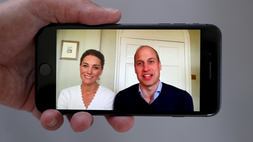 In this May 15, 2020, file photo, Prince William, Duke of Cambridge, and Catherine, Duchess of Cambridge, speak to crisis volunteers on a video-call to mark the first anniversary of Shout85258 in London, England.