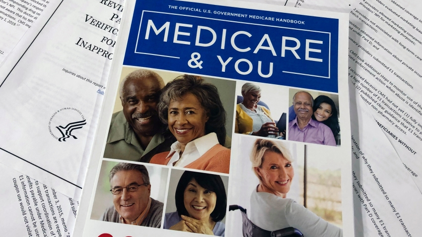 In this Feb. 13, 2020, file photo, the official U.S. Government Medicare Handbook for 2020 over pages of a Department of Health and Human Services, Office of the Inspector General report, are shown in Washington.