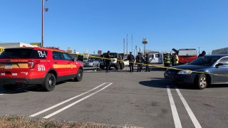 Police investigate after a body was found in a burning Jeep