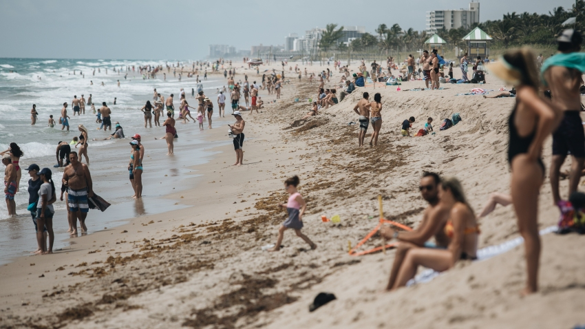 People gather on the beach Delray Beach, Florida, U.S., on Saturday May 23, 2020.