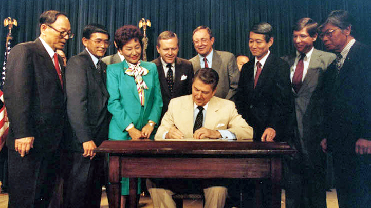 Ronald Reagan Signs Japanese Reperations