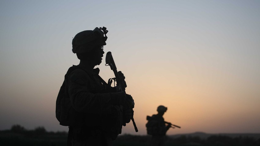 In this file photo, U.S. Marines with the 2nd Marine Expeditionary Brigade, RCT 2nd Battalion 8th Marines Echo Co. step off in the early morning during an operation to push out Taliban fighters on July 18, 2009 in Herati, Afghanistan.