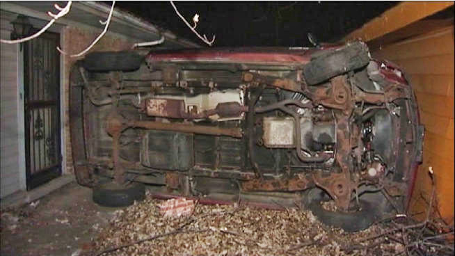 car-flipped-wedged