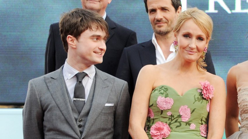 "In this July 7, 2011, file photo, Actor Daniel Radcliffe (L) and author J.K. Rowling attend the World Premiere of ""Harry Potter And The Deathly Hallows Part 2"" in Trafalgar Square in London, England."