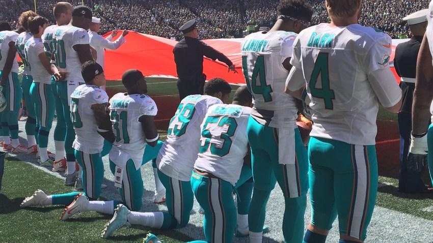 dolphin players kneel