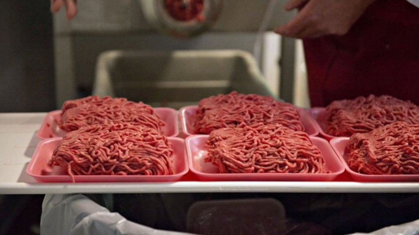 FILE -Ground beef is portioned onto trays in the meat department of a supermarket in Illinois, on Wednesday, July 2, 2014. Saturday, the USDA issued a recall notice for ground beef products shipped to stores across the country.