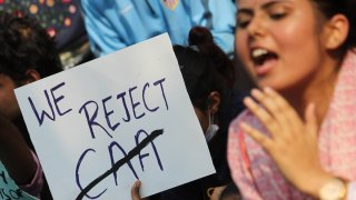 Students and activists hold placards and shout slogans during a protest against Citizenship Amendment Act (CAA) in Mumbai, India on Dec. 16, 2019.